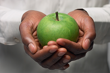 Holding Green Apple
